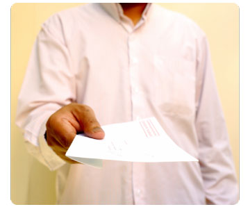 Photo of man holding piece of paper